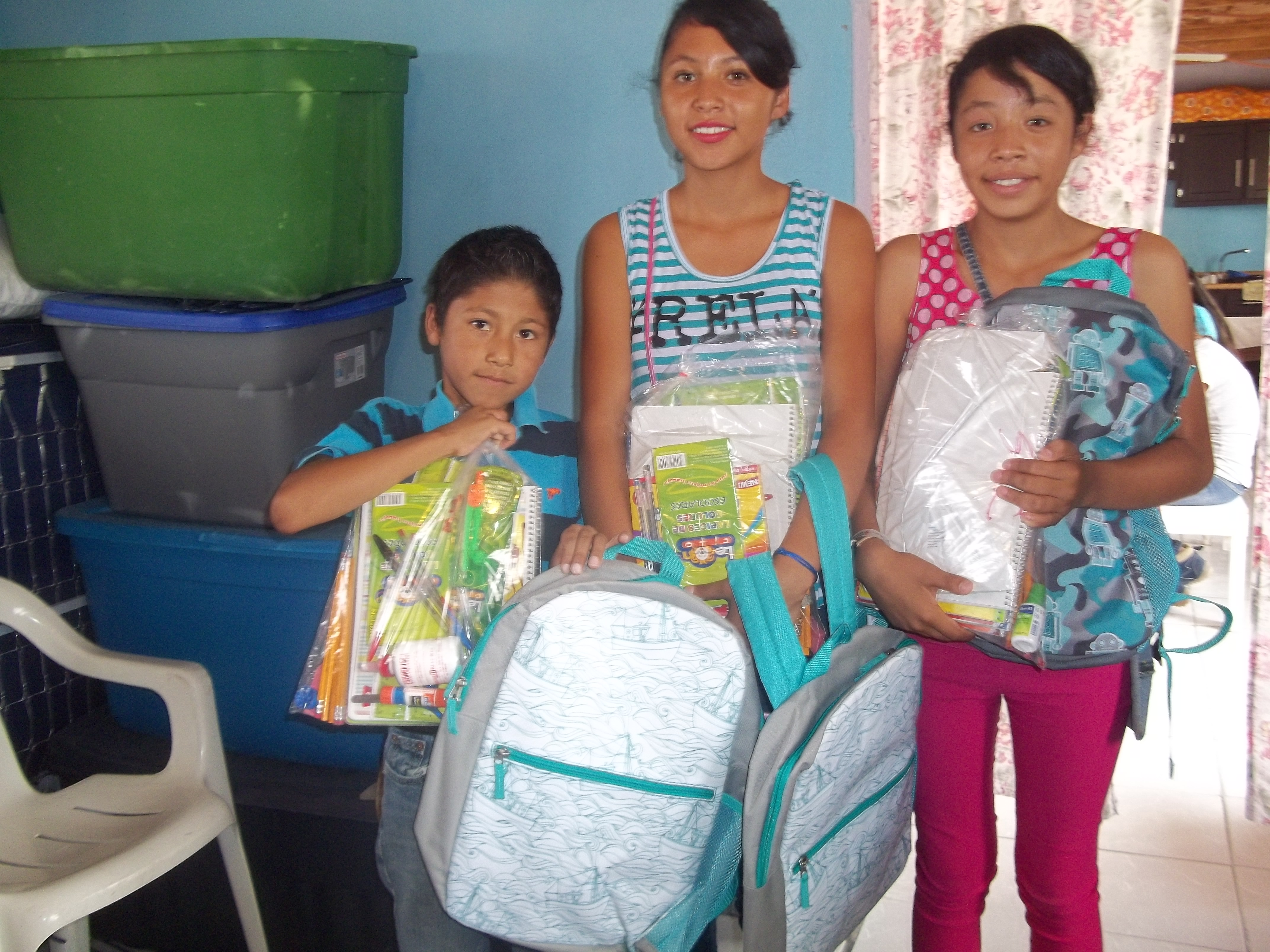 youth receiving backpacks full of school supplies
